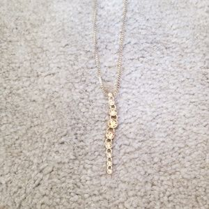 Fossil gold tone drop stone necklace